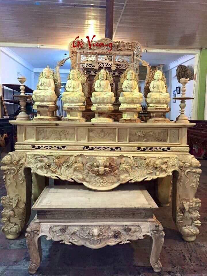 Mẫu sập thờ tứ linh kết hợp với bàn cơm để tiết kiệm không gian trên mặt sập
